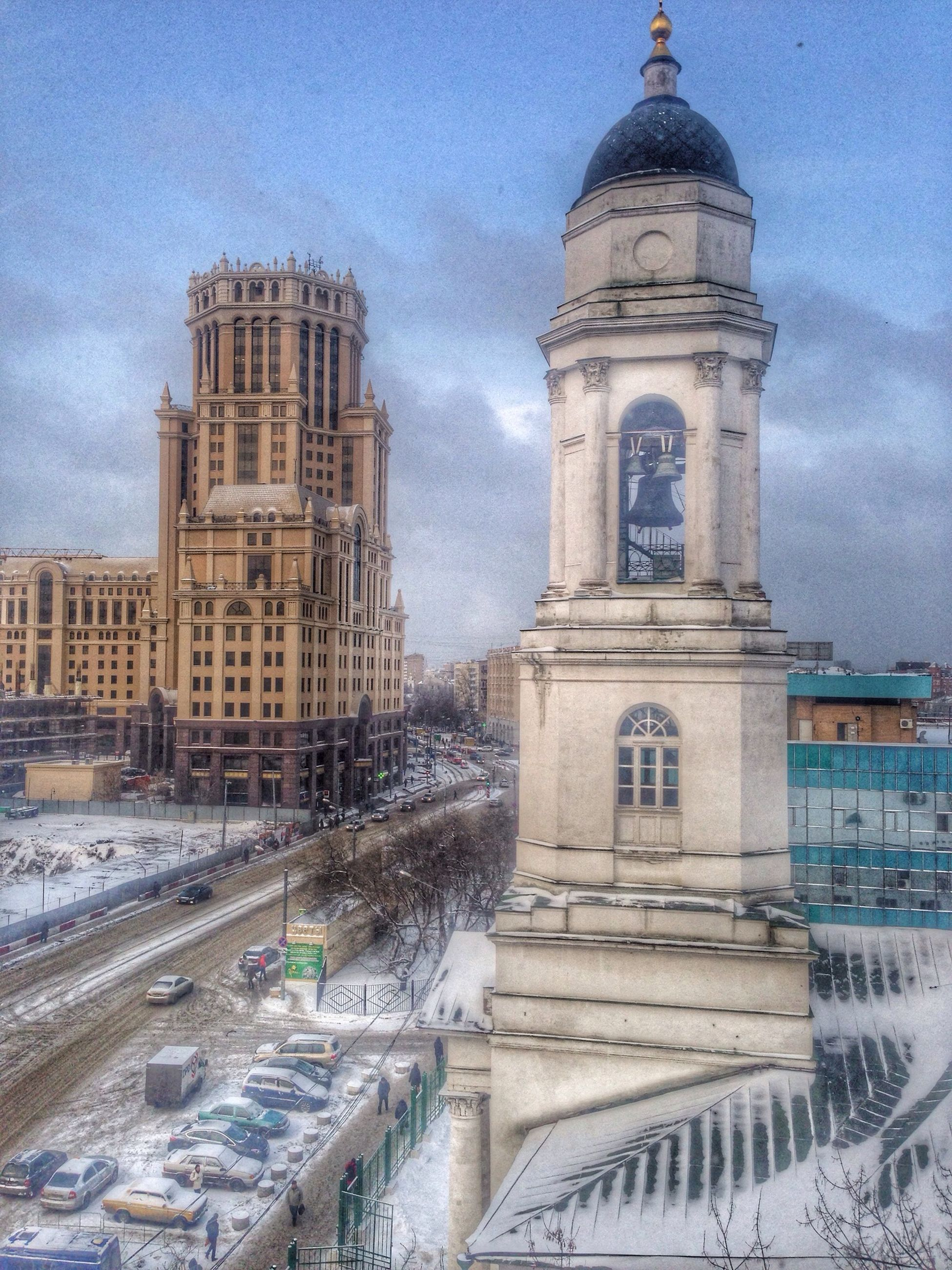 building exterior, architecture, built structure, winter, cold temperature, snow, sky, church, religion, season, weather, place of worship, city, dome, cloud - sky, travel destinations, water, cathedral