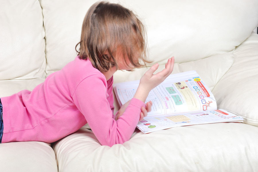 Girl student on the couch with a notebook Furniture One Person Bed Indoors  Women Domestic Room Child Childhood Sitting Bedroom Lifestyles Holding Girls Real People Pillow Sofa Home Interior Hair Hairstyle Innocence Book Student Notebook Paper School Book