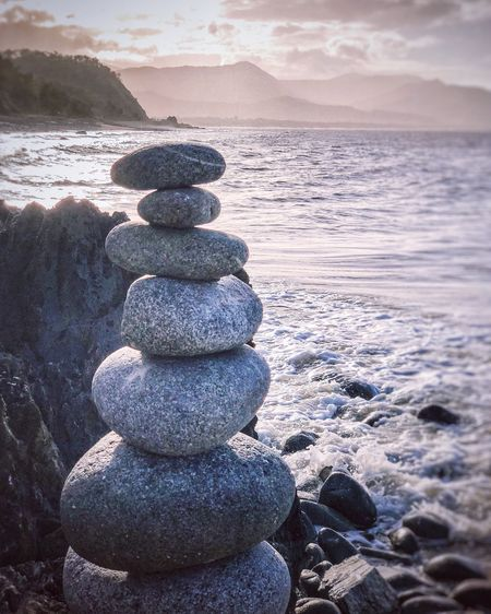 Balancing Rocks Balancing Rocks Water Sea Beach Land Sky Beauty In Nature Nature Solid Scenics - Nature Tranquility Rock Stack Stone - Object No People Wave Horizon Over Water Rock - Object Zen-like Balance Pebble