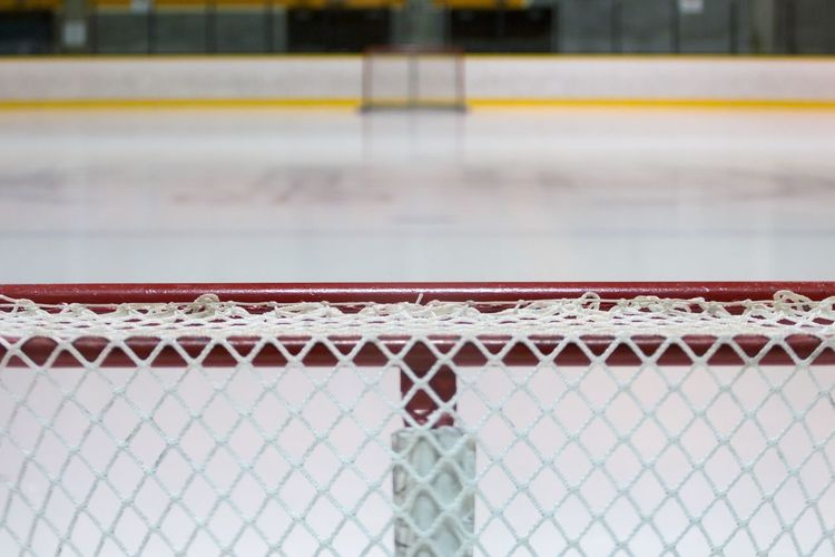 Close-up of goal post at ice hockey rink