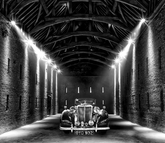 Classic car in the barn Backgrounds Barn Black And White Burning Car Flame Illuminated Indoors  Light Light And Shadow Night No People Spotlight Tunnel