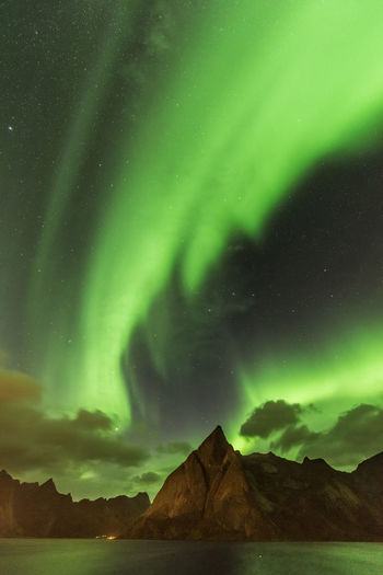 Breathtaking and unexpected Aurora Borealis Beautiful EyeEm Nature Lover Green Lofoten Islands Nature Northern Lights Norway Polar Lights Sky And Clouds The Week On EyeEm Mountain Night Outdoors Sky Stars Travel Destinations Capture Tomorrow
