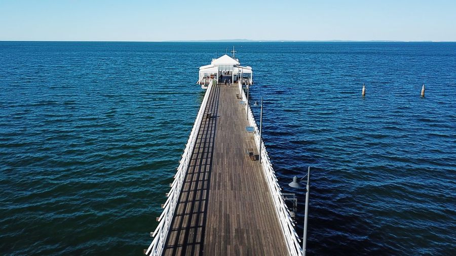 DJI Mavic Pro Wood Wood - Material View White Aerial View Diminishing Perspective Jetty View Dock Jetty Pier Water Horizon Over Water Direction Tranquil Scene Scenics - Nature Built Structure Nature Transportation Beauty In Nature Outdoors Architecture The Way Forward Nautical Vessel Sky No People Horizon Blue Day Sea