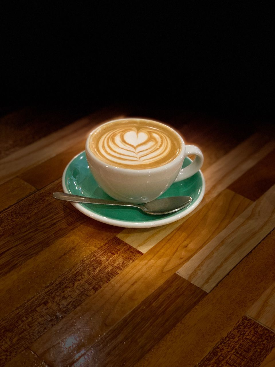 HIGH ANGLE VIEW OF COFFEE ON TABLE AT HOME