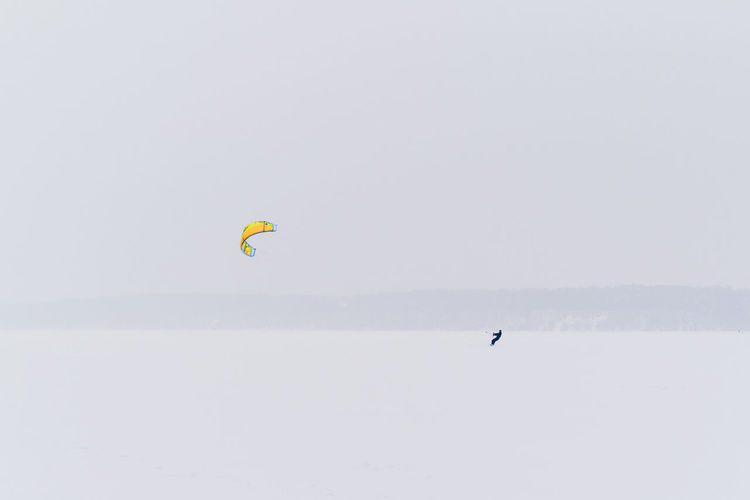 Sport Adventure Extreme Sports Leisure Activity Outdoors Winter Sport Winter Kiteboarding Snowboarding Exploration Kitesurfing Kitesurfer Snow Frozen Lithuania Kaunas Snowstorm Alone Brave Extreme Weather Beauty In Nature Scenics - Nature Lifestyles Unrecognizable Person The Great Outdoors - 2019 EyeEm Awards