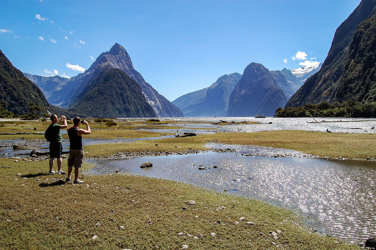 My Adventure Buddies taking in the scenery in Milford Sound, New Zealand Adventure Buddies Beauty In Nature Exploring Geology Hill Idyllic Landscape Mountain Mountain Range Nature Outdoors Physical Geography Remote Scenics Tranquil Scene Tranquility Traveling Trip
