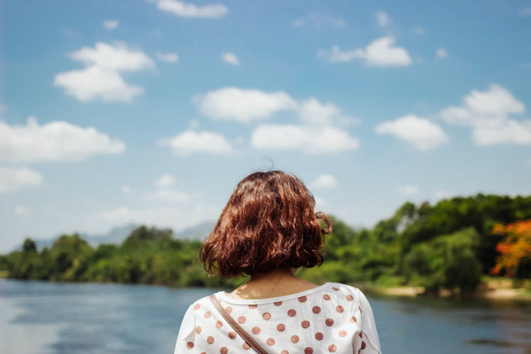 woman back standing in front of blurred background nature view Adult Adults Only Beauty In Nature Cloud - Sky Day EyeEm Best Shots EyeEm Gallery Focus On Foreground Headshot Lake Nature One Person One Woman Only Only Women Outdoors People Real People Rear View Sky Tree Water Women Young Adult