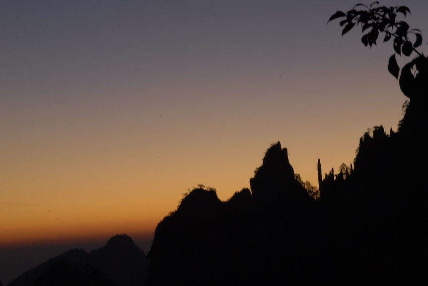 Anhui China Photos Beauty In Nature China Clear Sky Horizon Huangshan Mountain Nature No People Outdoors Scenics Silhouette Sky Sunrise Sunset The East Is Red Travel Destinations Tree Yellow Mountain