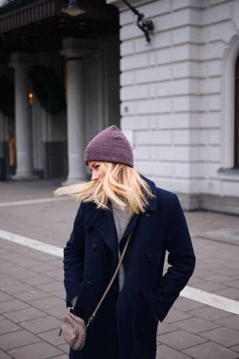 Autumn chills in sthlm Girl Hair Model Streetphotography Autumn Street Fashion Architecture Real People One Person Building Exterior Built Structure Walking Outdoors Knit Hat Lifestyles Women Day Warm Clothing Blond Hair Young Adult Adult People UrbanMind