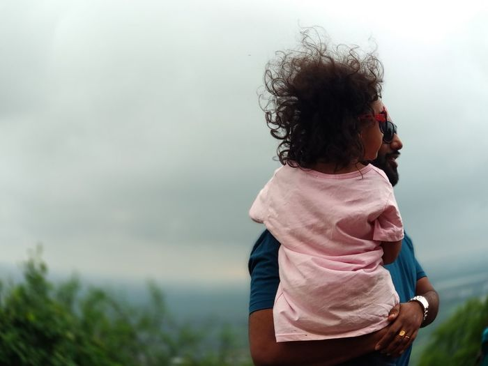 EyeEm Selects Childhood Child Tree Back Curly Hair Happiness Standing Rear View Beauty Family Bonds