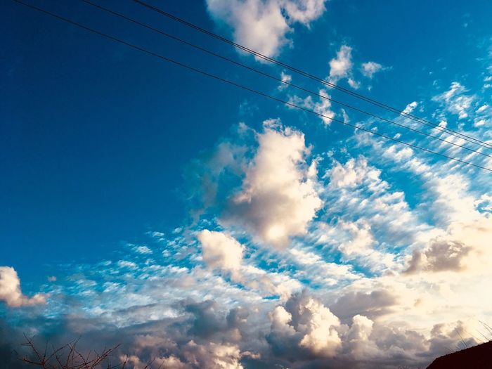 Cloud - Sky Sky Low Angle View Blue Cable Nature No People Technology Beauty In Nature Power Line  Connection Scenics - Nature Electricity  Tranquil Scene Day Outdoors Transportation Telephone Line Power Supply Tranquility