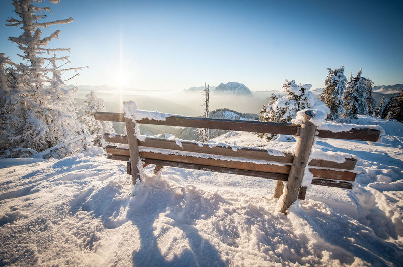 Sunny day in the snowy mountains Snow Cold Temperature Winter Nature Tree Beauty In Nature Scenics - Nature Tranquility Sky Sunlight Tranquil Scene Land Fence Barrier Boundary Plant Environment No People Day Outdoors Sun Snowcapped Mountain