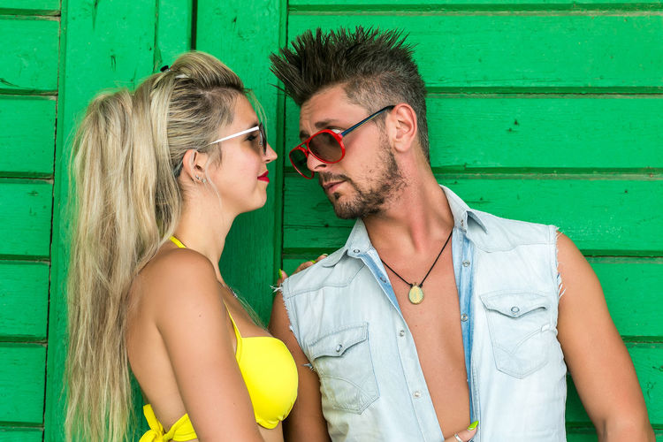 Togetherness Young Adult Glasses Two People Young Men Young Women Couple - Relationship Men Love Bonding Real People Casual Clothing People Sunglasses Adult Fashion Lifestyles Smiling Leisure Activity Positive Emotion Hair Hairstyle