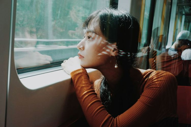 life Train #photography #outfit #OOTD #City INDONESIA #potrait Indonesia_photography HongKong Hongkongphotography Young Women Sitting Women Looking Through Window Window Cafe Beautiful Woman Close-up Thinking Red Lipstick