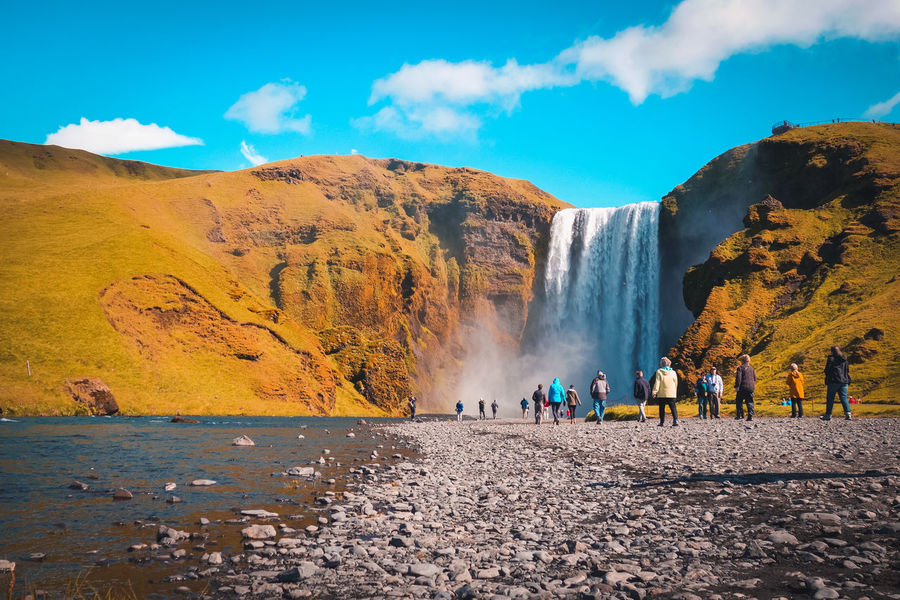 Incredible Skogafoss waterfall and skogar river in Iceland. Iceland Beauty In Nature Group Of People Iceland_collection Power In Nature Powerful Powerful Nature Scenics - Nature Skogafoss Skogafoss Falls, Iceland Skogar Water Waterfall