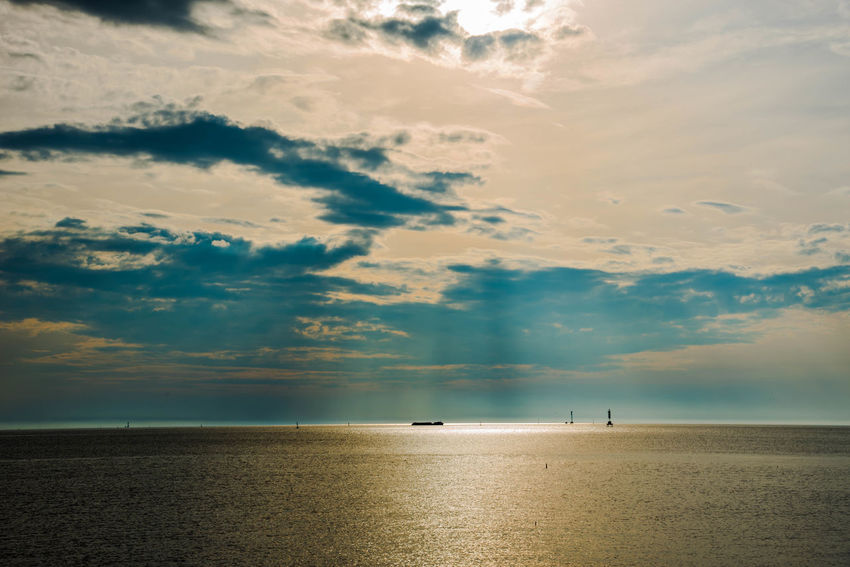 View of sunset in the evening is a beautiful water reflection. Beach Beauty In Nature Cloud - Sky Day Drilling Rig Horizon Over Water Nature Nautical Vessel No People Offshore Platform Oil Pump Outdoors Scenics Sea Silhouette Sky Sunset Tranquil Scene Tranquility Water