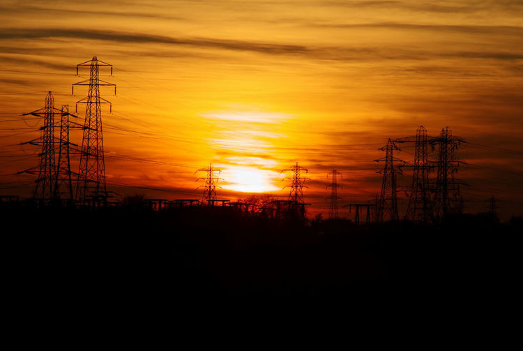A sunset during our highest temperatures on record in the UK for February. It reached 21°C according to the temperature in my car Sun Electricity Pylon Sunset Power Station Electricity  Technology Fuel And Power Generation Cable Silhouette Industry Power Line  Romantic Sky Dramatic Sky Atmospheric Mood