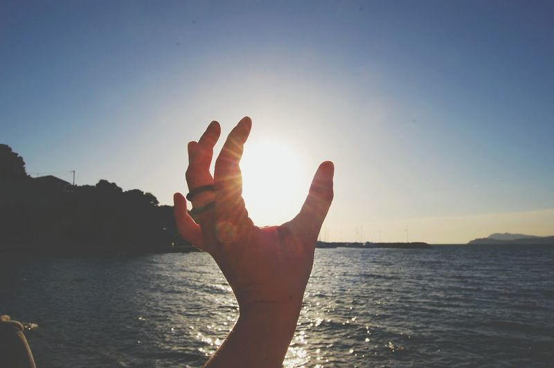 Human Body Part Human Hand One Person Politics And Government Sunset Wellbeing Adult Adults Only Close-up Outdoors Sky Beach People Nature Day Miles Away Premium Collection Getty X EyeEm BYOPaper! Breathing Space The Week On EyeEm Lost In The Landscape
