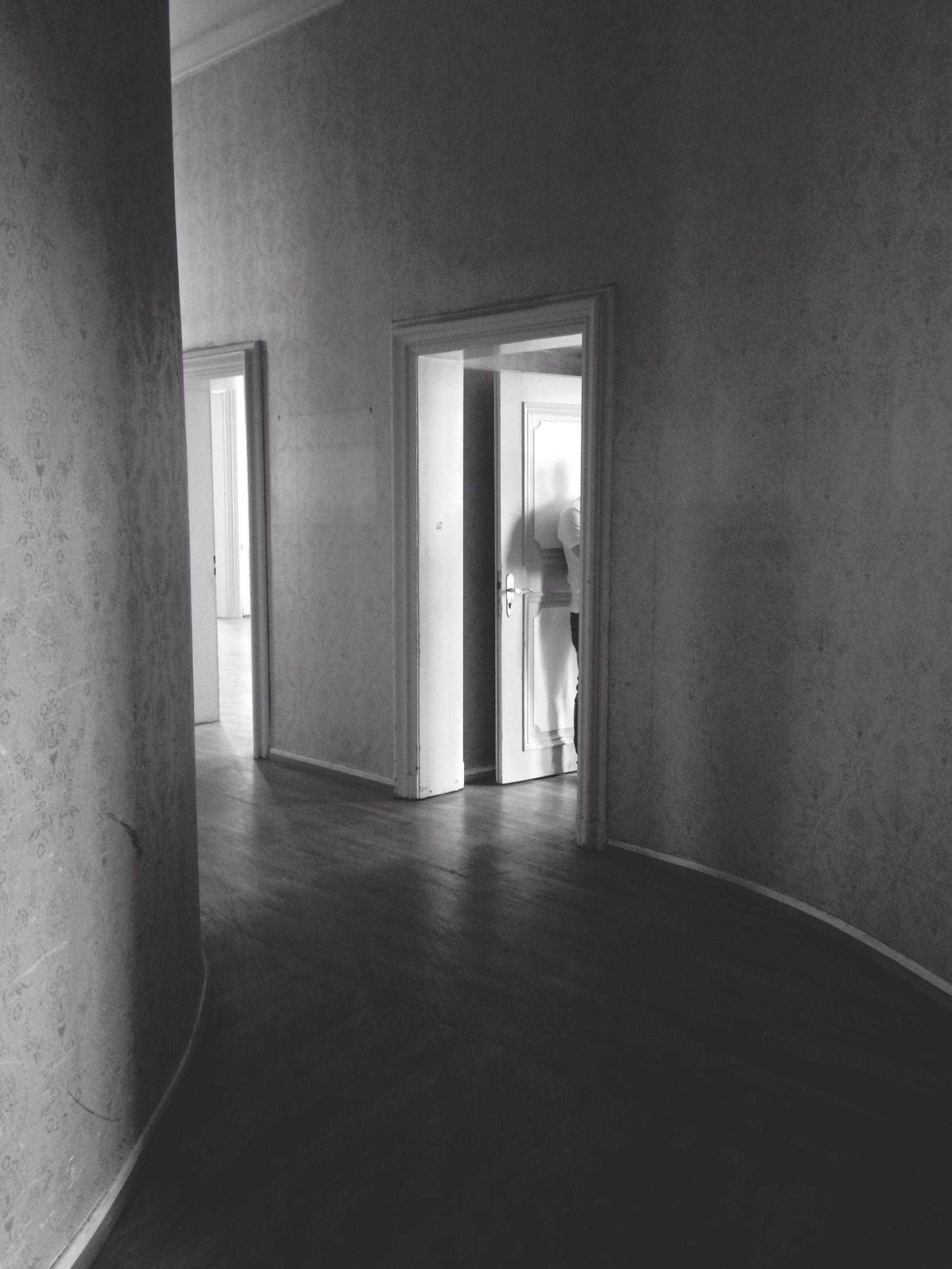 indoors, architecture, built structure, window, corridor, door, flooring, empty, home interior, absence, house, wall - building feature, doorway, wall, sunlight, building, day, no people, narrow, tiled floor