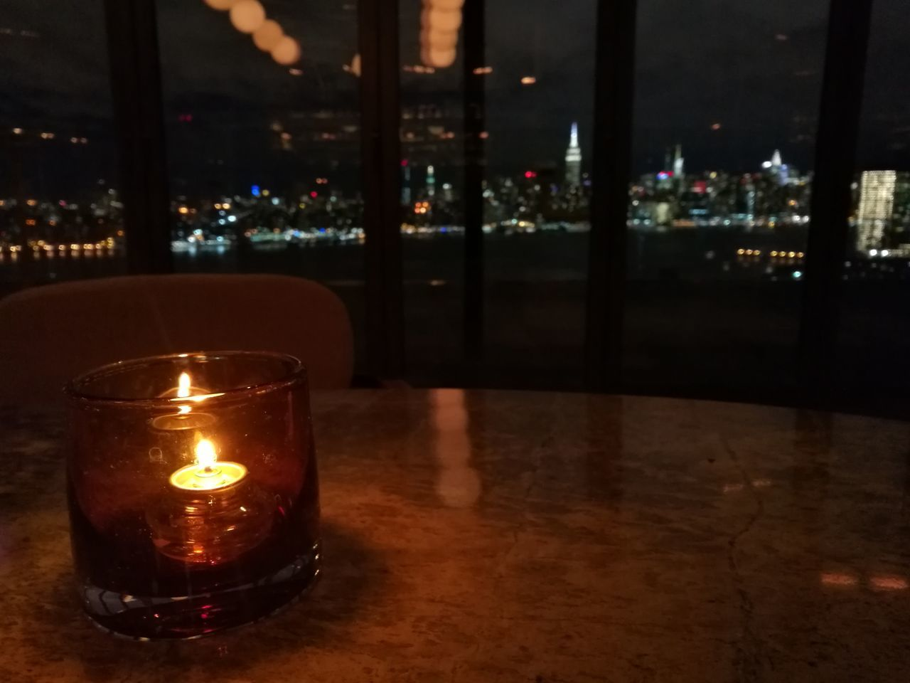 flame, illuminated, burning, candle, glowing, heat - temperature, night, no people, table, focus on foreground, tea light, indoors, close-up, oil lamp