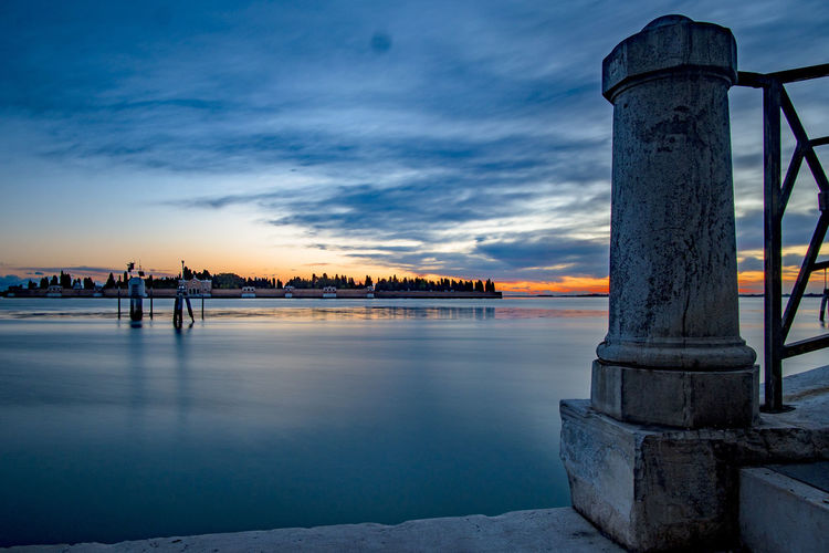 Architecture Beauty In Nature Blue Bridge - Man Made Structure Building Exterior Built Structure City Cloud - Sky Fondamente Nuove No People Outdoors San Michele Scenics Sea Sky Sunset Travel Destinations Tree Venice, Italy Water