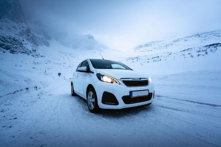 View of car on snow covered mountain