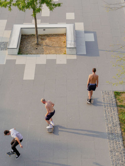 URBANANA #urbanana: The Urban Playground Ollie Skateboarding Adult Architecture Available Light City Day Footpath Full Length High Angle View Leisure Activity Lifestyles Males  Men Outdoors People Real People Shadow Street Streetphotography Togetherness Walking
