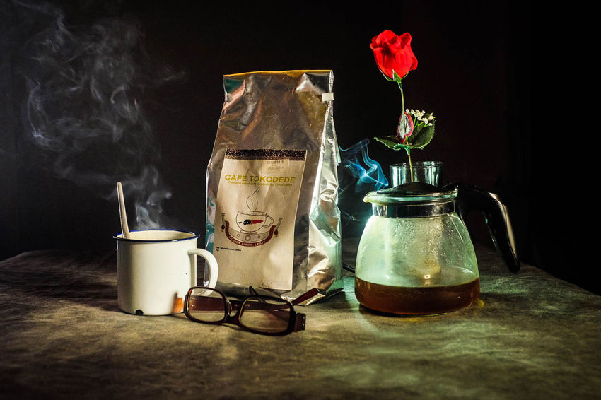 Morning rituals Black Background BrewedCoffee Coffee Time Flower Freshness Indoors  Jar No People Reading Glass Roses Are Red Table
