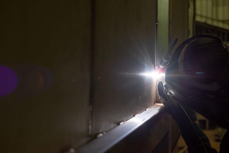 Man seen through window at night