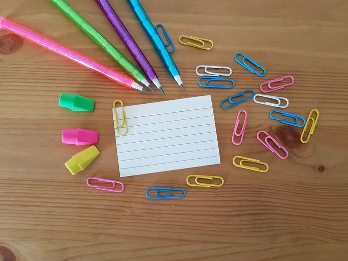 Elementary School Kindergarten Back To School Note Paper Blank Paper First Day Of School Teachers Teaching Classroom School Days Writing Tools Stationary Office Desk Homework Drawing EyeEm Selects Paper Clip Office Multi Colored Paper Directly Above Desk Wood - Material Colored Pencil Pencil Writing Instrument Eraser School Supplies Crayon