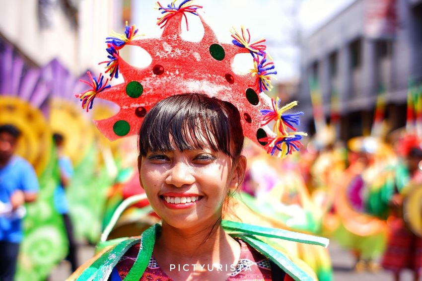 """Iha"" A portrait of a student during the Kadayawan sa Davao Festival, She is participating the Indak-Indak sa Kadalanan event and celebration. Fujifilm XT100 7artisans Randomphotos Composition Hobbyistphotographer Fuji Ndfiltered Philippines Photographer Landscapephotography Lensculture Streetphotographyworldwide Street_focus_on Newbie Streetphotography Streets_storytelling Streetsleaks Streetphotographycommunit Streetclassics City Portrait Multi Colored Smiling Beautiful Woman Happiness Headshot Looking At Camera Arts Culture And Entertainment Celebration"