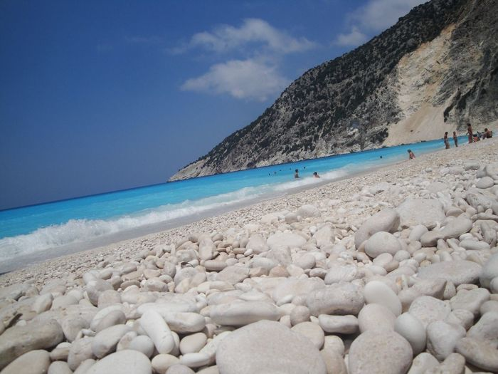 Myrtos Beach Cefalonia Sea Beach Water Sky Nature Scenics Beauty In Nature Tranquil Scene Outdoors Day Rock - Object Tranquility Cloud - Sky Horizon Over Water Sand Mountain Men Pebble Beach People Femalephotographerofthemonth 43GoldenMoments Taking Photos Popular Photos