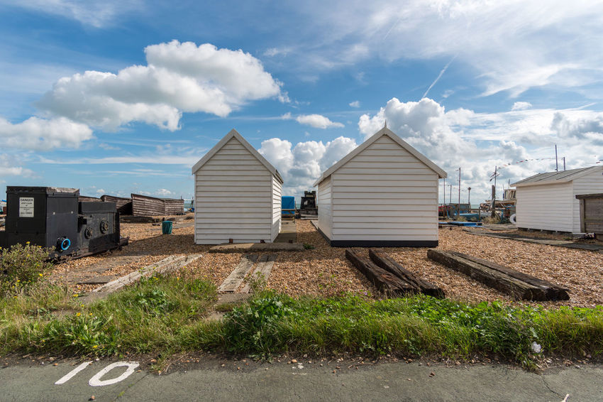 Beach Huts And Sky Walimex 12mm Architecture Beach Huts Blue Building Exterior Built Structure Cloud - Sky Day Grass Nature No People Outdoors Sky