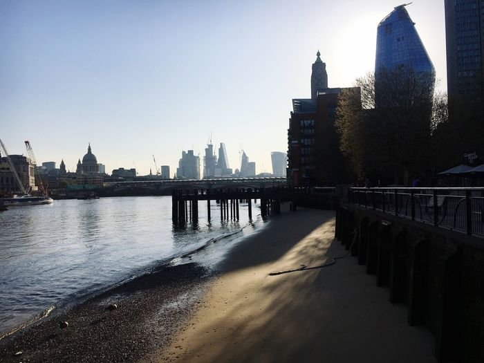Walking to work Sunshine Oxo Tower St Paul's Cathedral Pier Beach Built Structure Architecture Building Exterior Water City Sky Nature Building River Urban Skyline Office Building Exterior Outdoors Tall - High Clear Sky Tourism Tower