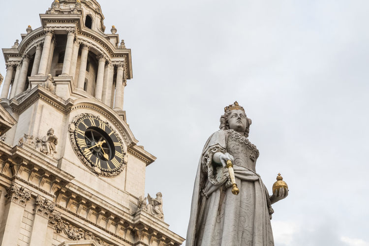 St. Paul's Cathedral and the statue of Queen Anne in London. Low angle view. Sculpture Human Representation Statue Architecture Low Angle View Building Exterior No People Religion Place Of Worship Clock Face Travel Destinations London St.Pauls Cathedral Famous Place United Kingdom Built Structure Low Angle View Overcast Roman Catholic Church
