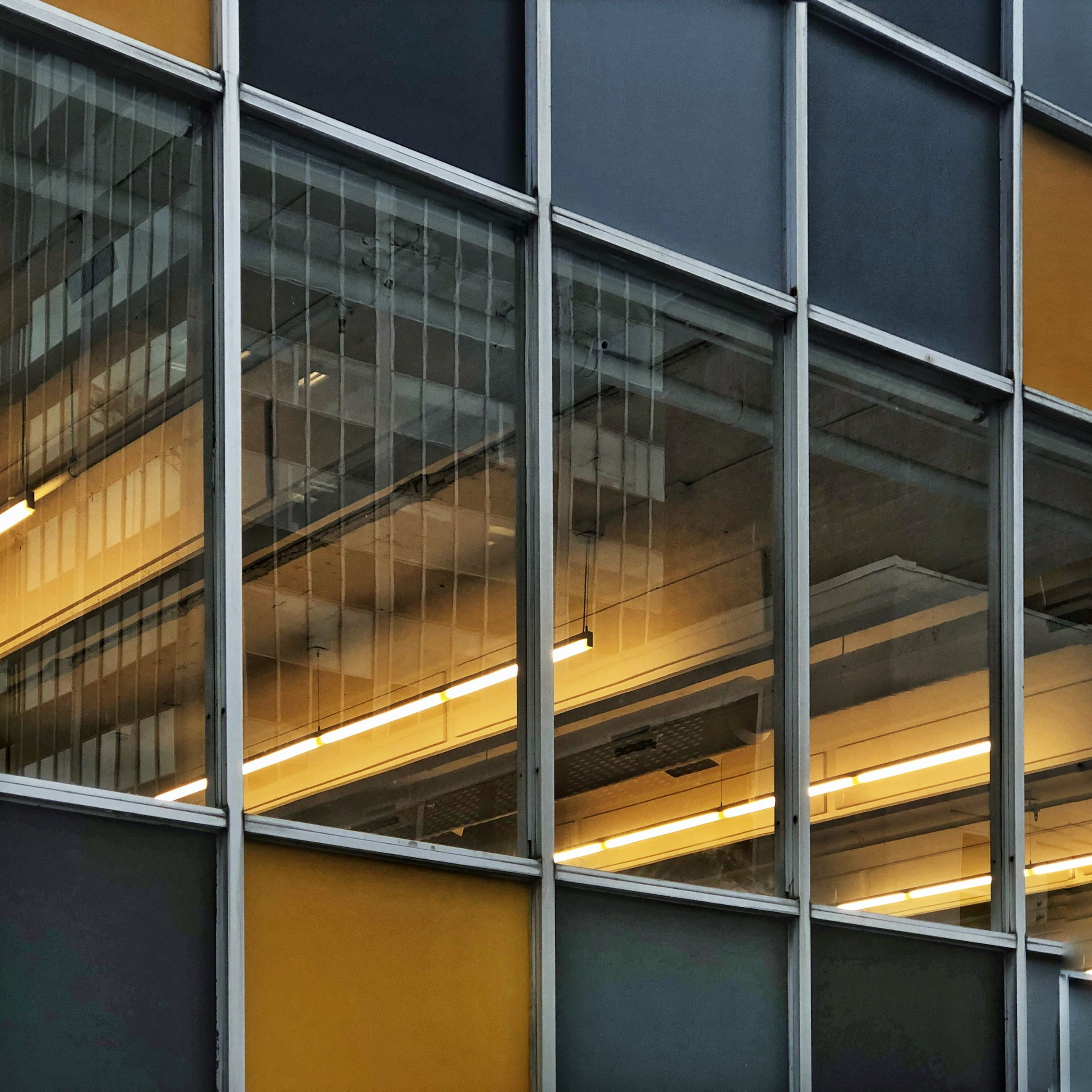 built structure, building exterior, architecture, glass - material, window, reflection, no people, building, transparent, full frame, modern, outdoors, backgrounds, yellow, city, day, office, pattern, low angle view, office building exterior