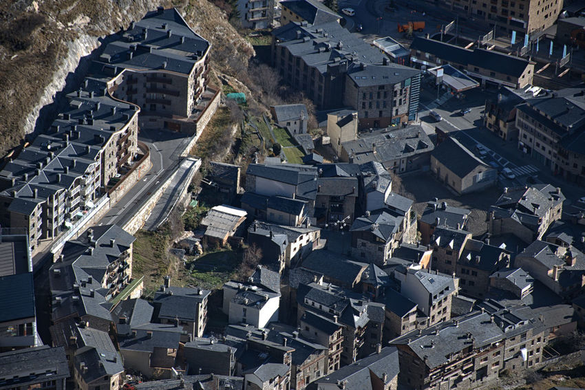 Aerial view of Canillo town in Andorra. Architecture Built Structure Building Exterior Town Community TOWNSCAPE Sunlight Crowded High Angle View Roof Housing Settlement Residential District Building Outdoors