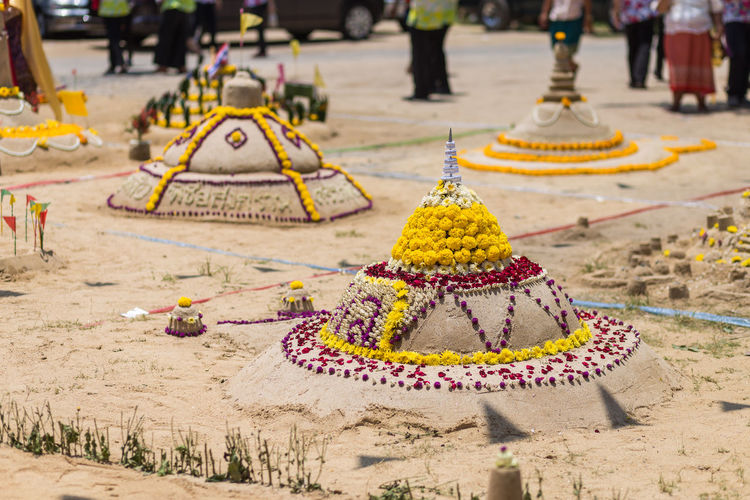 Sandcastles at temple during sunny day