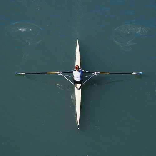 High Angle View Of Woman Sculling In River