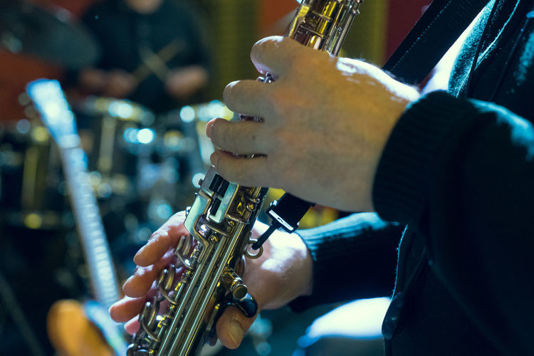 Midsection Of Man Playing Saxophone During Performance