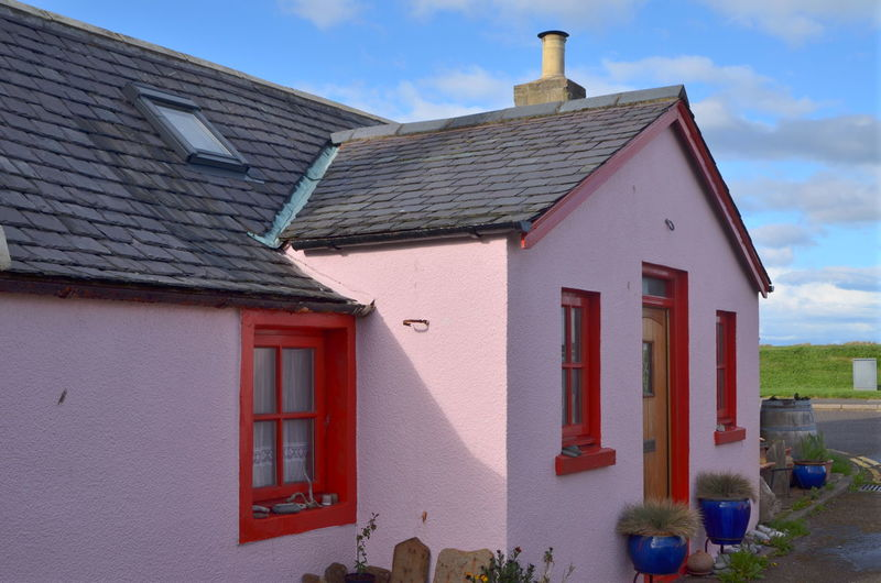 pink house Architecture Built Structure Building Exterior Building House Roof Residential District No People Nature Window Day Outdoors Red Sky Multi Colored Entrance Plant Blue Roof Tile Architecture City Sunlight Cottage