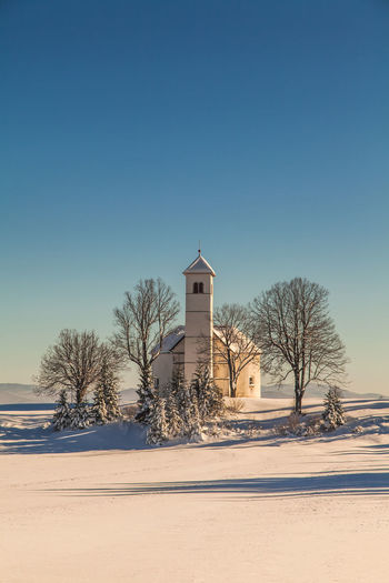 Church Shades Of Winter Slovenia Slovenia Scapes Architecture Bare Tree Beauty In Nature Building Exterior Built Structure Clear Sky Cold Temperature Copy Space Frozen Landscape Nature No People Outdoors Place Of Worship Scenics Snow Tranquility Tree Weather White Color Winter