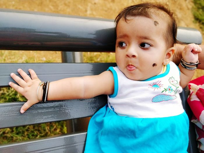 Cute Baby Girl On Bench In Park