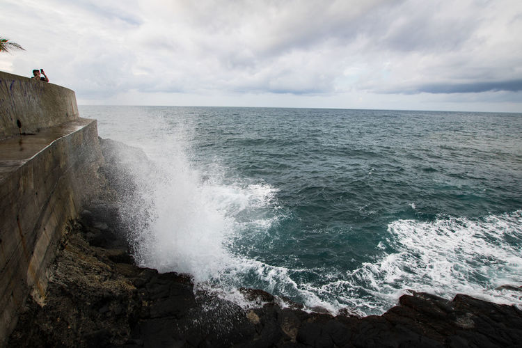 waves crashing on rocks in tahiti French Polynesia Travel Beauty In Nature Breaking Cloud - Sky Day Hitting Horizon Horizon Over Water Land Motion Nature No People Outdoors Pacific Ocean Power Power In Nature Rock Scenics - Nature Sea Sky Splashing Water Wave