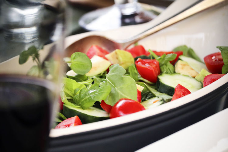 Dish of green salad. Red Spoon Arugula Bowl Chopped Close-up Dinner Food Food And Drink Freshness Fruit Healthy Eating Herb Indoors  Kitchen Utensil Leaf Vegetable No People Ready-to-eat Salad Serving Size Tomato Vegetable Vegetarian Food Wellbeing Wine