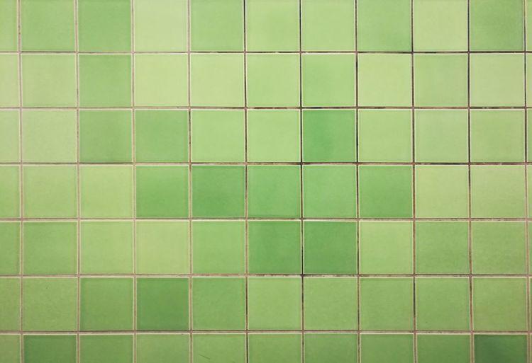 Full frame shot of green tiled wall