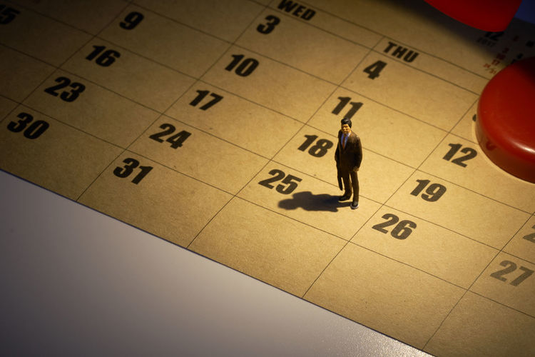 High angle view of figurine on calendar