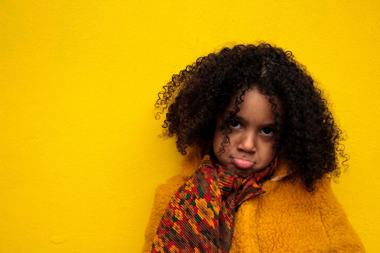 Portrait Of Sad Girl On Yellow Background