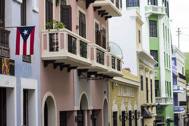 Streets of San Juan Puerto Rico months before hurricane. Colors Puerto Rico San Juan Travel Architecture Balcony Building Exterior Built Structure City Color Colorful Day Flag No People Outdoors Patriotism Puerto Rico Flag Residential Building Street Window