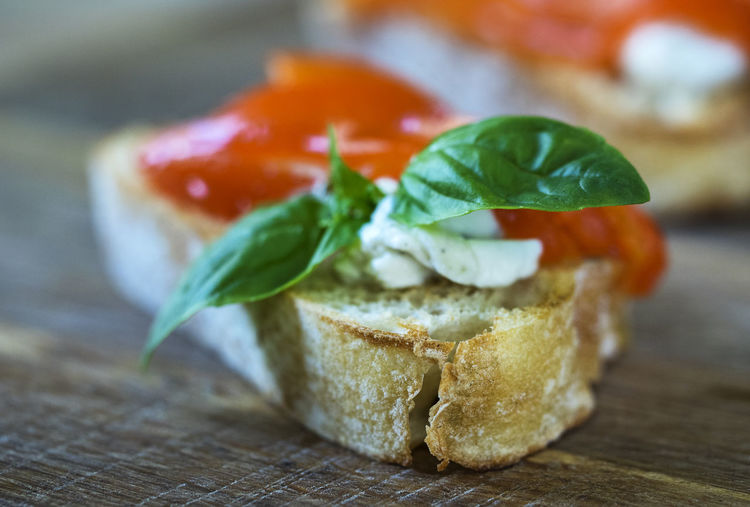 Close-up of bruschetta with bell pepper and feta cheese